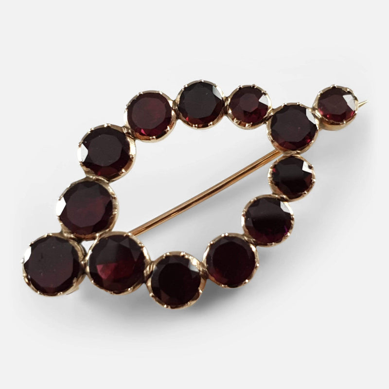 the George III gold flat cut garnet brooch viewed diagonally