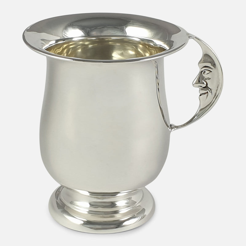 the silver christening cup with the Man in the Moon handle in view