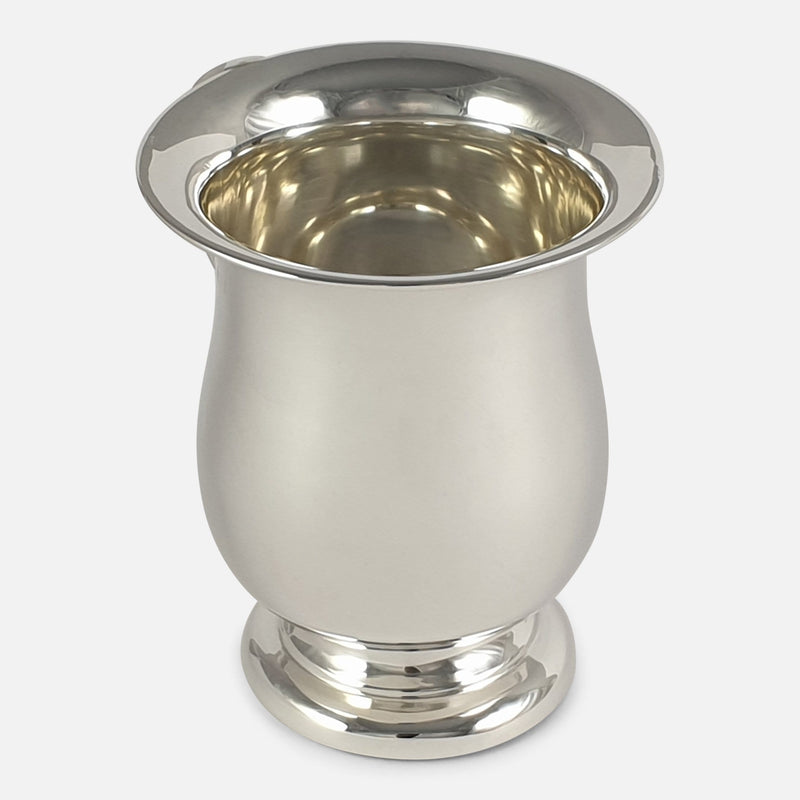 the cup with handle out of view to the rear