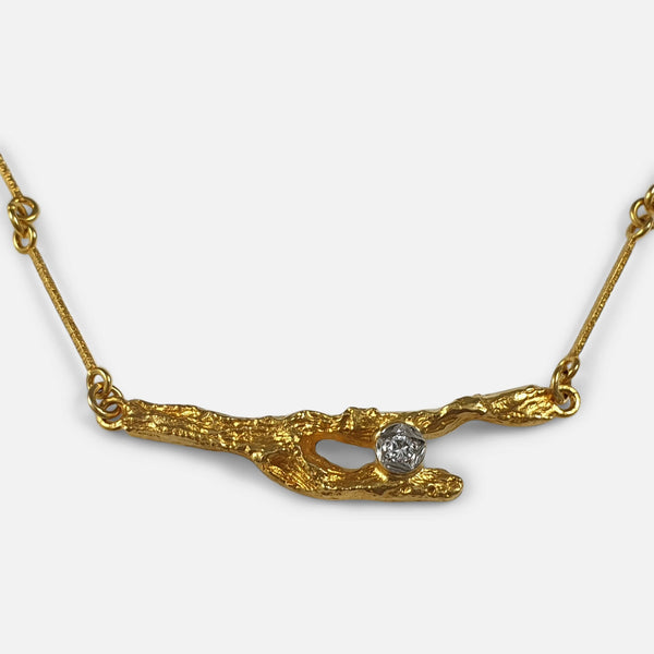 focused on the 18ct Gold and diamond pendant section of the Lapponia necklace