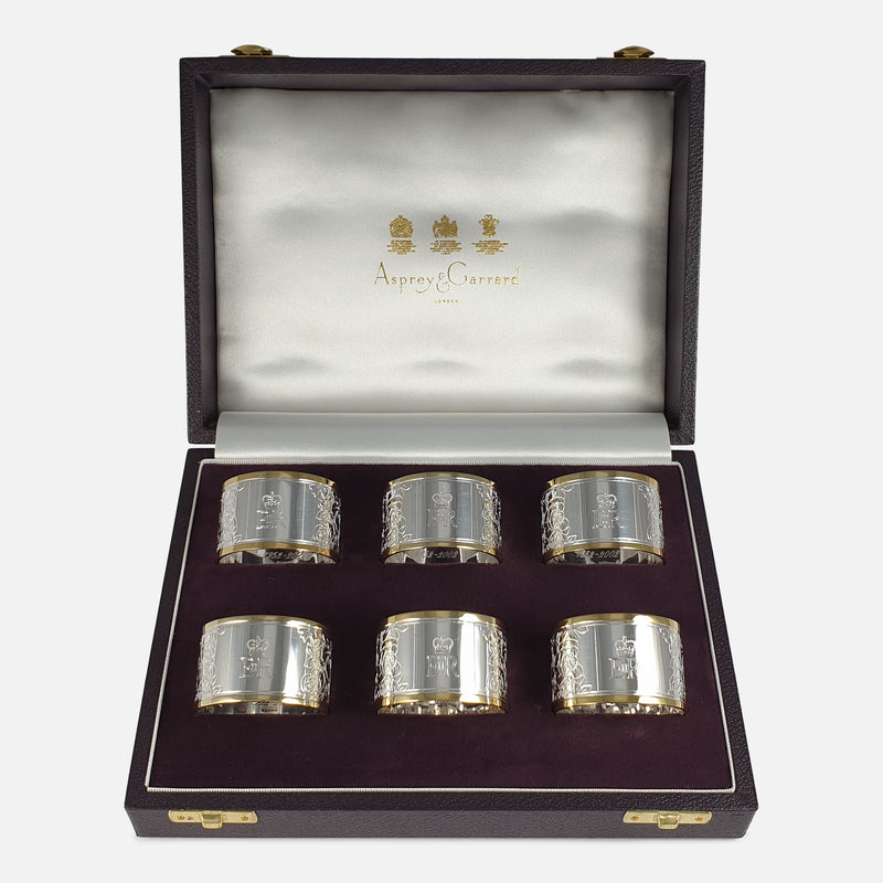 Set of Six Parcel-Gilt Britannia Standard Silver Napkin Rings, 2002 viewed in a case