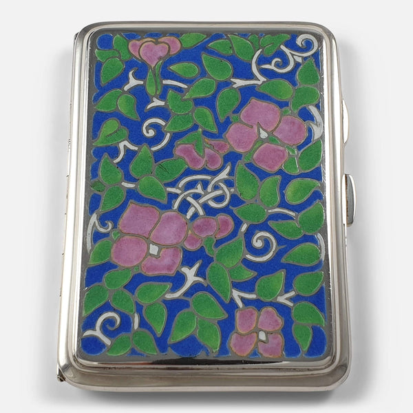 The vintage silver cigarette case focused on the enamel frontage