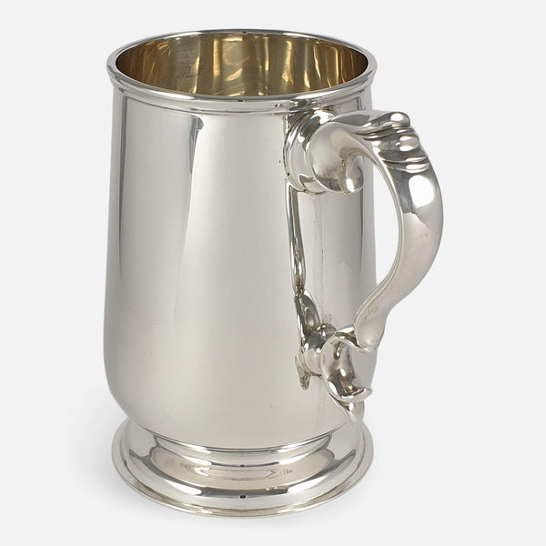 the tankard with handle angled towards the front