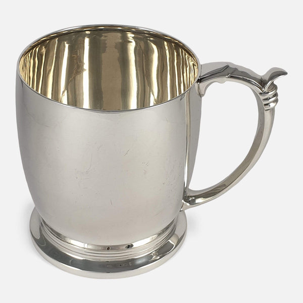 the sterling silver pint tankard to side with handle in view