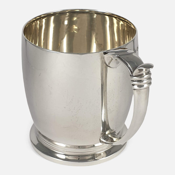 the tankard turned to have handle to forefront