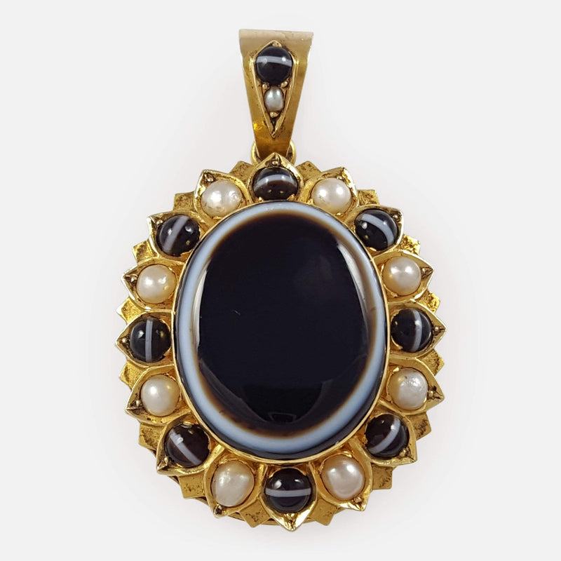 the Victorian 15ct gold banded agate and pearl mourning locket viewed from the front