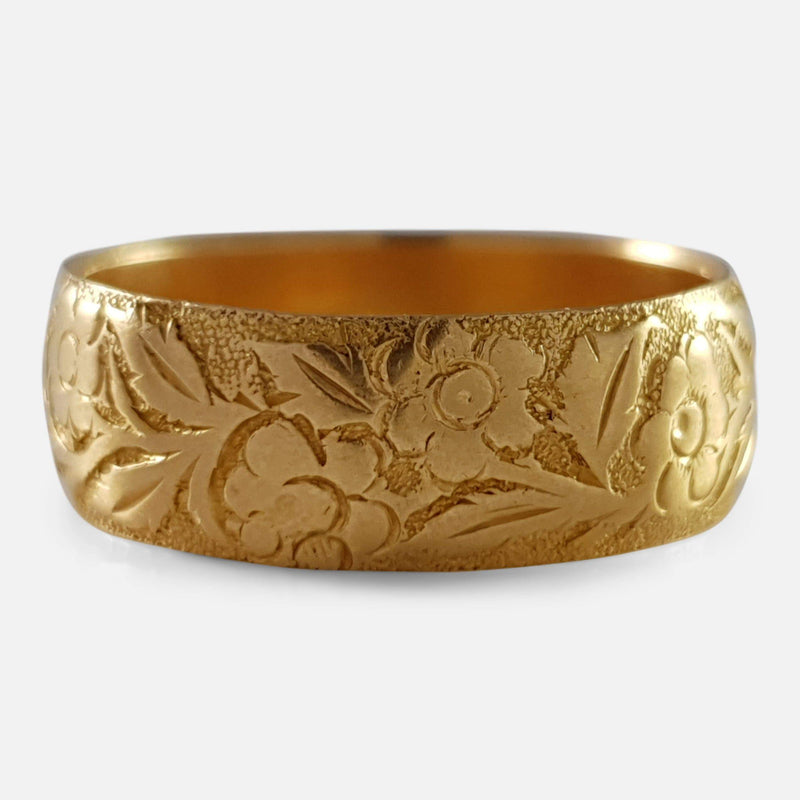 the Victorian 18ct gold foliate engraved wedding band viewed from the front