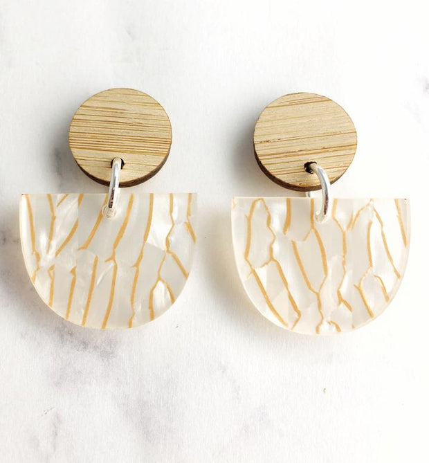 A stunning white statement earring