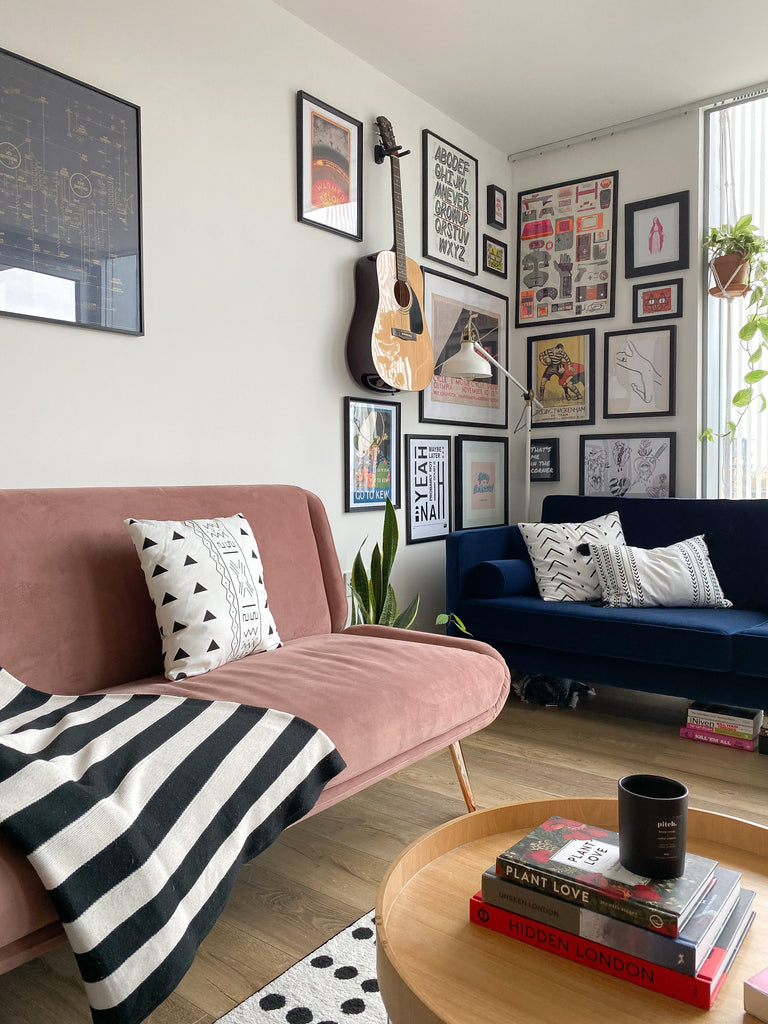Small living room with blue and pink velvet sofas