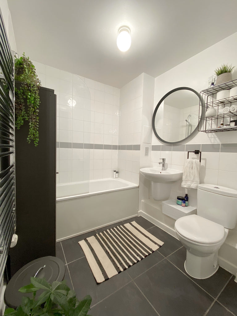 White bathroom with gray tile and accents
