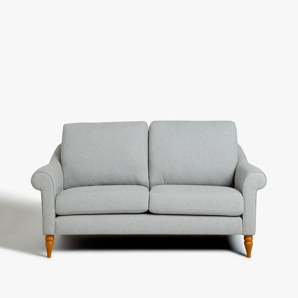 Small grey two seater sofa