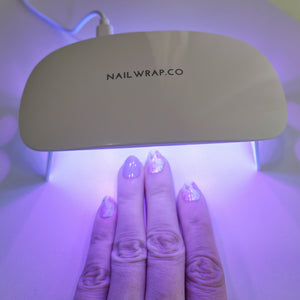 Buy UV Led Lamp Nail Wraps at the lowest price in Singapore from NAILWRAP.CO. We Ship Worldwide. Over 300 designs! Instant designer nail art under 10 minutes