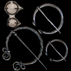 Iron Brooches