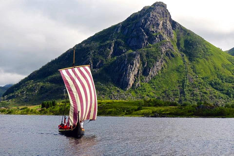 Longship in the fjord at Lofotr Viking Festival