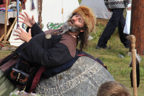 Storyteller on a runestone at Lofotr Viking Festival - Viking Dragon Blogs