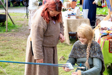 Tablet weaving lessons at Lofotr Viking Festival
