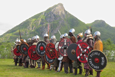 Viking warriors lining up at Lofotr Viking Festival - Viking Dragon Blogs