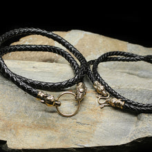 Load image into Gallery viewer, Braided Leather Necklace with Bronze Ferocious Wolf Heads on Rock