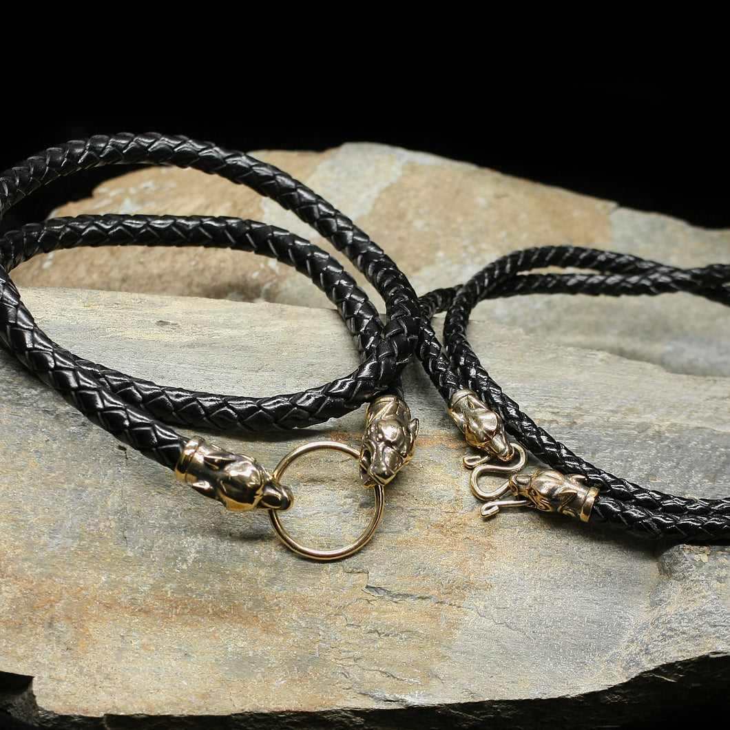 Braided Leather Necklace with Bronze Ferocious Wolf Heads on Rock