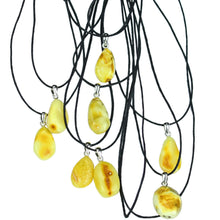 Load image into Gallery viewer, Yellow Amber Amulet Pendants on White Background - Amber Viking Jewelry