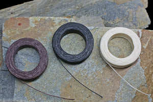 Waxed Linen Thread Reels on Rock