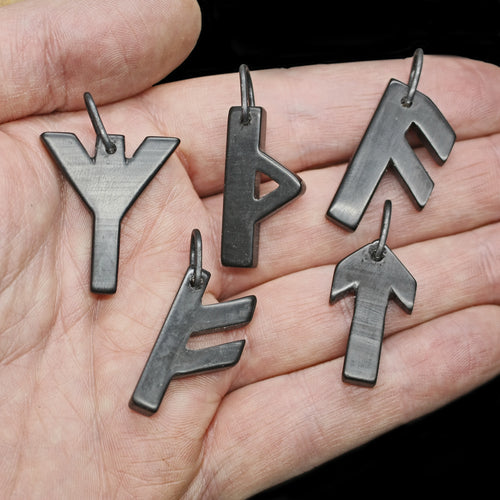 Black Horn Futhark Rune Pendants on Hand