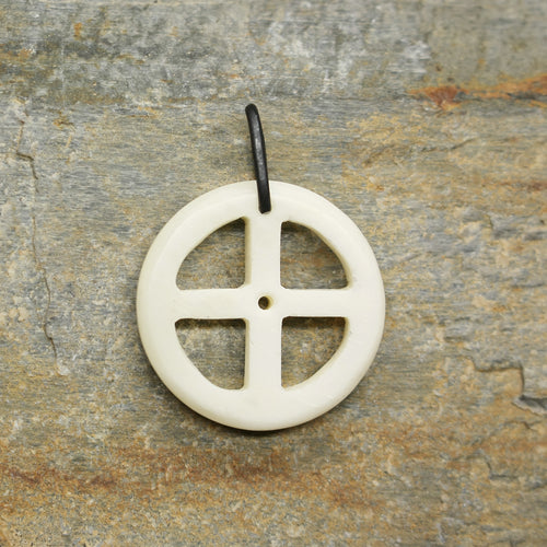 Bone Sun Cross Odin Pendant on Rock