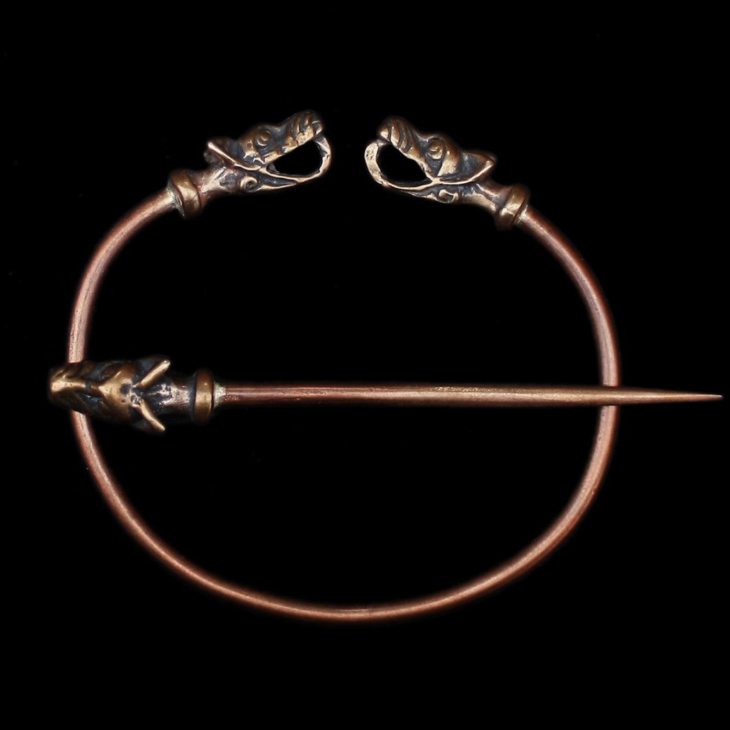 Bronze Penannular Brooch with Icelandic Wolf Heads