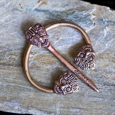 Bronze Danish Penannular Brooch with Viking Heads on Rock - Viking Jewelry