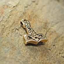 Load image into Gallery viewer, Small Bronze Interlace Thors Hammer Pendant on Rock