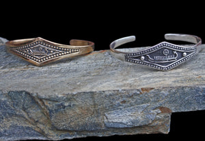 Viking Longship Bracelets on Rock - Viking Jewelry