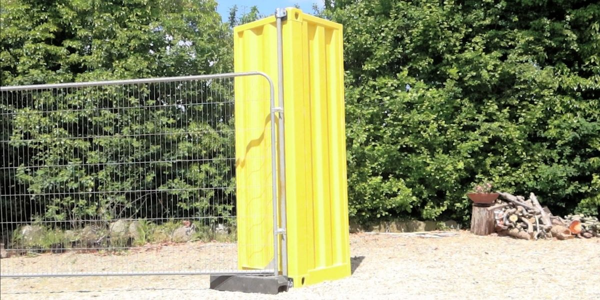 Attaching heras fencing to a shipping container
