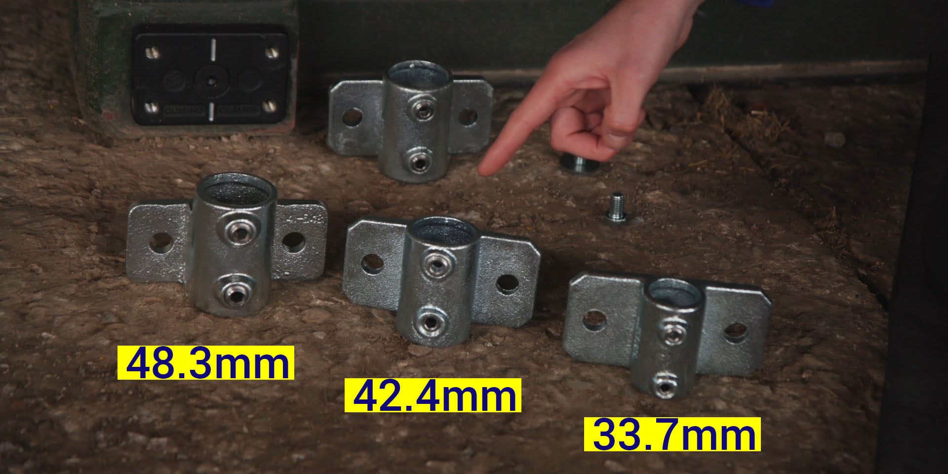 A hand points to the three different sizes of tube clamps