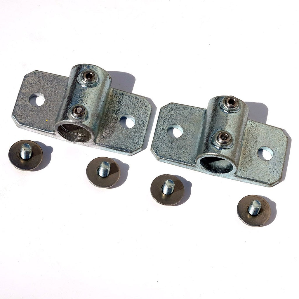 A pair of 34mm palm railing tube clamps with screws ans washers for bolting a 34mm steel tube to a shipping container using  a domino clamp