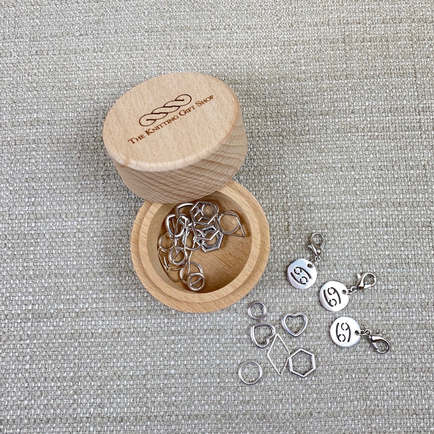 Zodiac Knitting Stitch Markers in a Tub