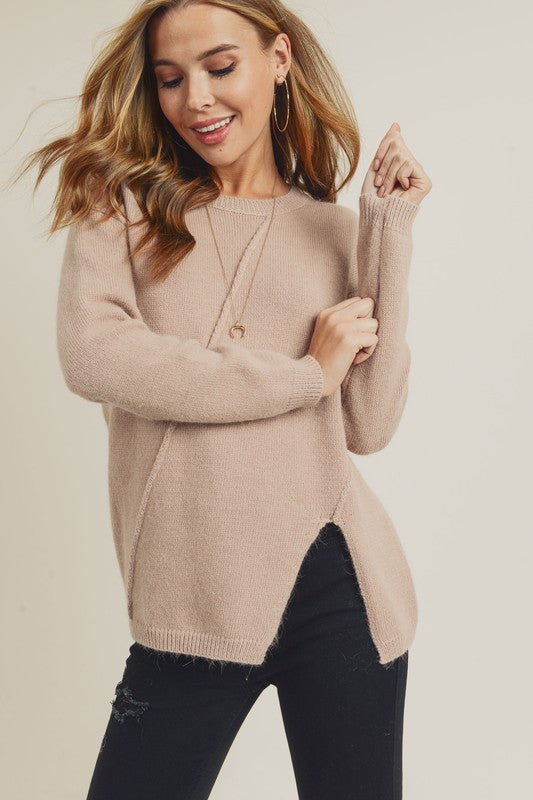 ASYMMETRICAL SLIT SWEATER