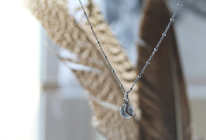 Luna Light crescent moon necklace.