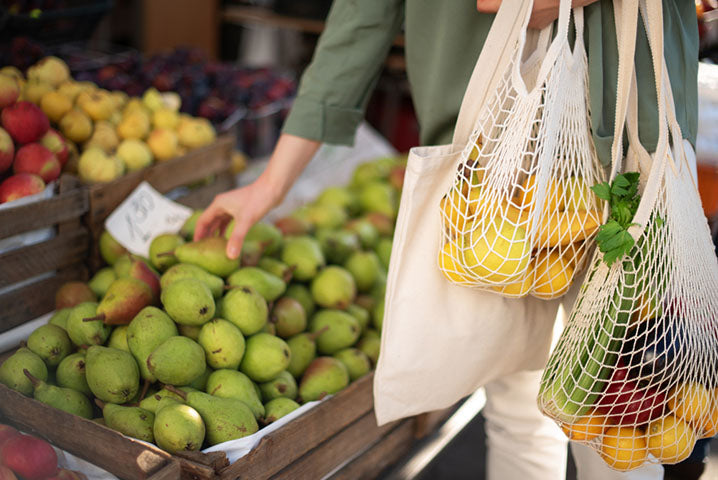 grocery store shopping with reusable bags