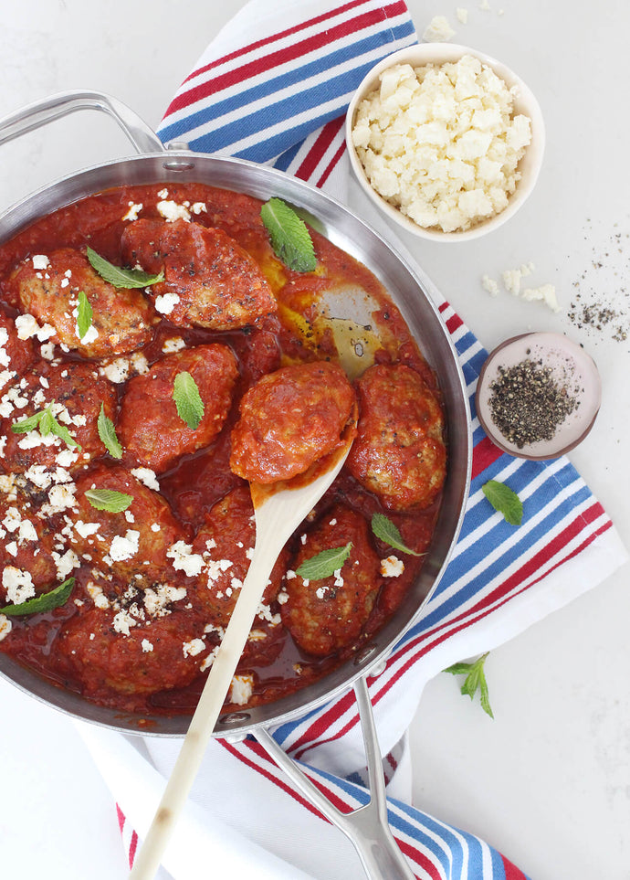 These Greek meatballs are hearty, tender and moist, and they come nestled in an intriguingly spiced tomato sauce