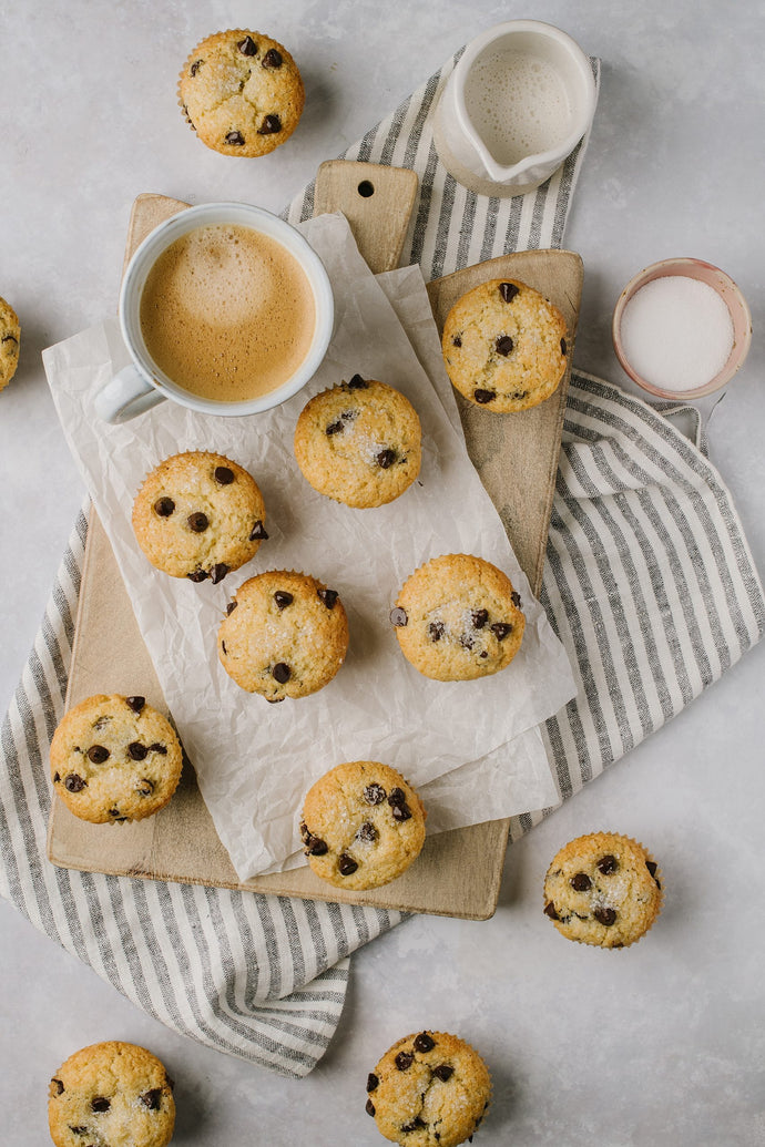 These are the best chocolate chip muffins, they come together in minutes and have a crunchy top with a fluffy interior with lots of chocolate chips!
