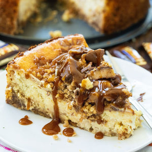 English Toffee Cheesecake is a rich and creamy cheesecake with toffee bits in the batter and crushed Heath bars and caramel sauce on top