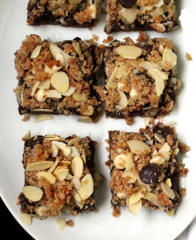 These vegan Layered Chocolate Chip Cookie Cookie Bars have it all — a layer of gluten-free shortbread topped by a layer of chocolate and all of this deliciousness smothered under a delicious almond-chocolate crumble