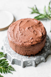 This easy Gluten Free Chocolate Cake is a showstopper! It's incredibly moist, made with almond flour and topped with the most delicious chocolate buttercream.