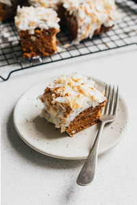 A simple vegan carrot cake with orange and cardamon and a maple sweetened coconut icing