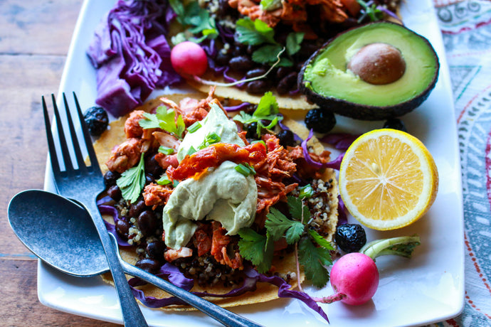 Build a better taco with these flavorful, healthy 100% plant-based tacos, which includes a spicy jackfruit filling, protein-rich black beans, high-fiber quinoa, crunchy cabbage, and a fluffy avocado crema
