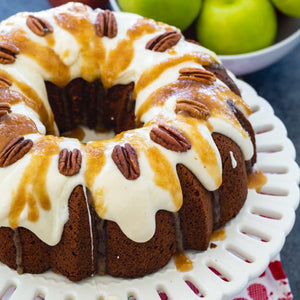 Caramel Apple Pound Cake- A moist pound cake with diced Granny Smith apple covered with a cream cheese icing and a caramel drizzle
