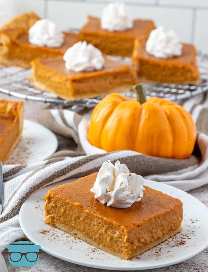 These Easy Pumpkin Pie Bars can be whipped up in minutes and are so easy to slice and serve! Perfect for Thanksgiving and the holidays!
