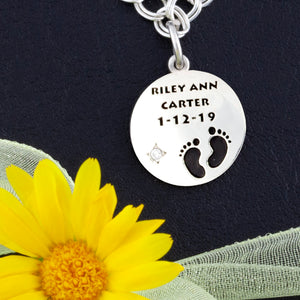 custom round bracelet charm with baby feet, name, birth date and birth stone
