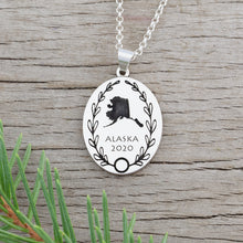 Load image into Gallery viewer, Personalized oval necklace engraved with country or state outline