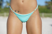 Adjustable brazilian bikini bottom with gold rings and sliders. Cheeky back coverage bikini